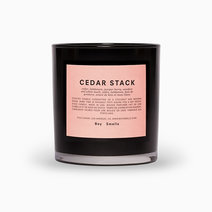 Boy smells cedar stack